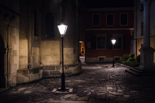 illuminated street at night. Old european city