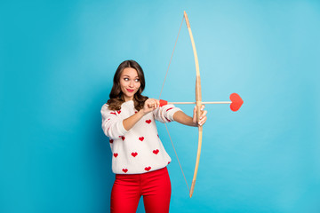 Portrait of her she nice attractive lovely charming winsome lovable cute focused cheerful cheery foxy cunning girl shooting amorous arrow isolated on bright vivid shine vibrant blue color background