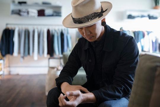 Stylish man in menswear clothing shop