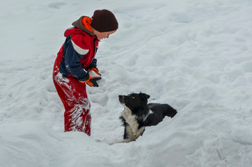 boy and his dog in the snow