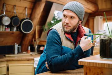 Man drinking coffee in cabin kitchen