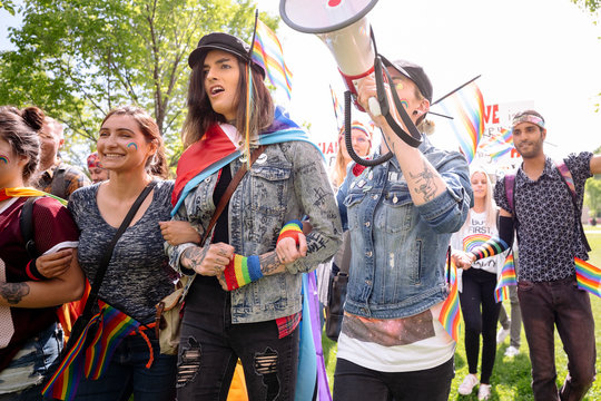 Students on gay pride march using megaphone