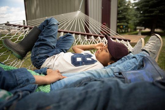 Kids laying on hammock