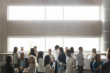 Business people talking, networking during conference coffee break