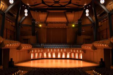 Lights illuminating empty auditorium stage