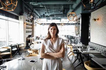 Portrait confident female restaurant owner