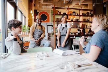 Servers meeting in restaurant