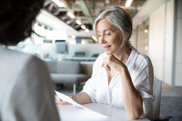 Senior businesswoman interviewing candidate