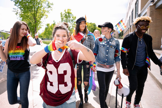 Cheerful young woman at gay pride festival with her friends