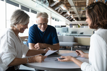 Senior clients discussing with financial advisor