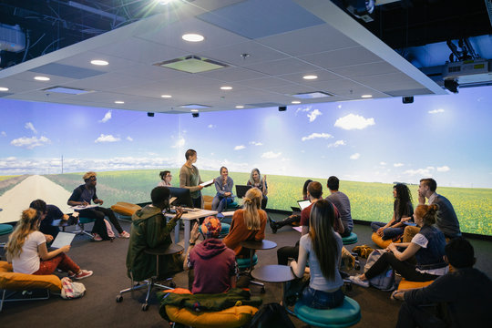 University students in VR classroom with lecturer