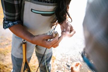 Woman fishing, preparing fishing line