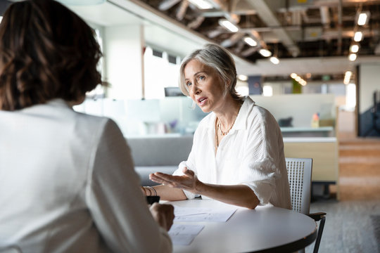 Senior woman discussing with financial advisor