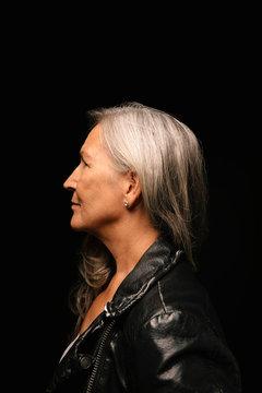 Profile portrait thoughtful, forward looking woman