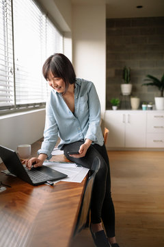 Businesswoman using laptop and smart phone in office