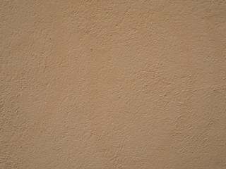 cement wall texture background in beige