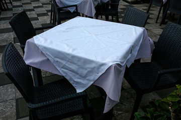 outdoor restaurant, empty table with white tablecloth
