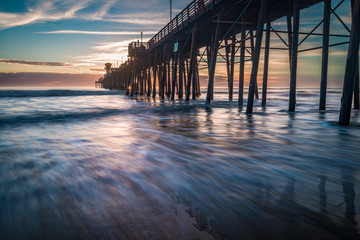 Long exposure sunset and surf at the pier