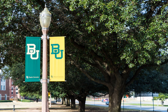 Waco, TX / USA - January 12, 2020: Baylor University banners on light poles, with copy space