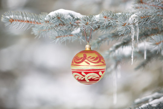 Christmas ornament hanging on tree with icicles