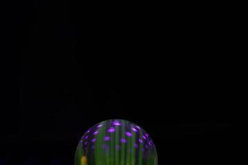Creative, mysterious green and purple globe sphere