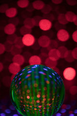 Creative, mysterious globe sphere on red spotted background
