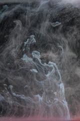 Creative, abstract liquid smoke waves rising
