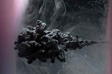 Creative, mysterious black liquid explosion