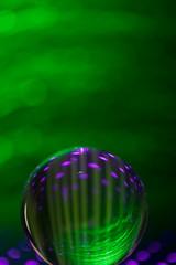 Creative globe sphere on green background