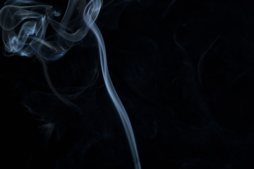 Smoke wave changing form, spiraling