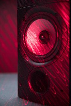 Red laser over grunge music speaker