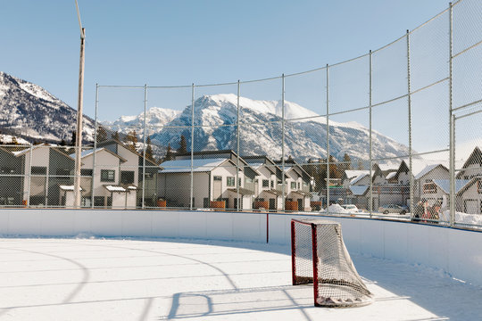 Ice hockey rink below mountains