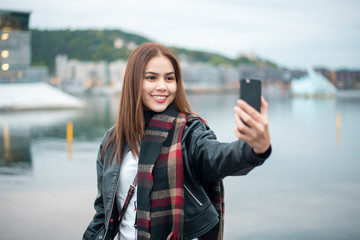 Woman is selfie with National Oslo Opera House  in Oslo, Norway
