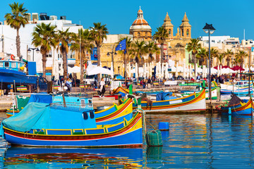 Foto op Canvas Blauw Traditional fishing boats in the Mediterranean Village of Marsaxlokk, Malta
