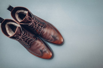 Shoes, stylish leather boots for men. Male winter, autumn or spring fashion. Footwear on grey background. Sale Wall mural