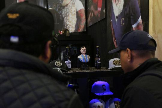 """Customers look at bottles of """"El Chapo"""" beer at the Expo Guadalajara, in Guadalajara"""