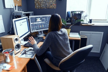 A Dark-haired Female Works In A Video Editor