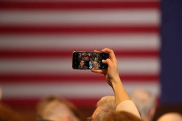 A woman uses a mobile phone before Democratic 2020 U.S. presidential candidate and U.S. Senator Elizabeth Warren (D-MA) rally in Newton