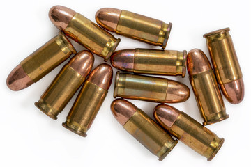 Pile of 9mm bullets on a white background. Image