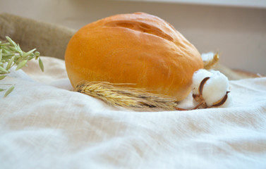 Loaf of bread on the tablecloth