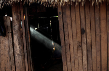 An indigenous girl of Kayapo tribe is pictured inside her house during a four-day pow wow in Piaracu village near Sao Jose do Xingu