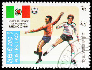 Acrylic Prints Chicken Postage stamp printed in Laos shows Play Scenes, World Cup Football serie, 5 Lao kip, circa 1985