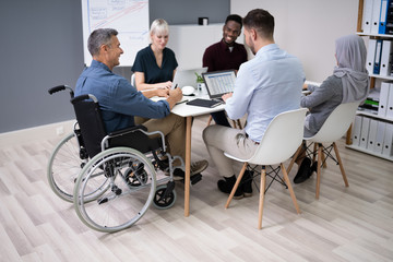 Disabled Businessman In Conference Room Wall mural