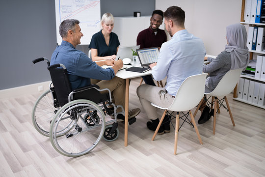 Disabled Businessman In Conference Room