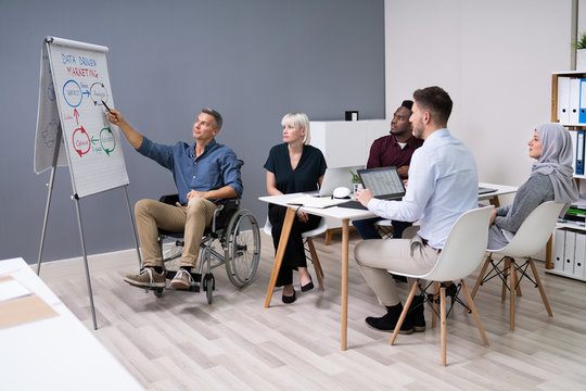 Disables Businessman Giving Presentation