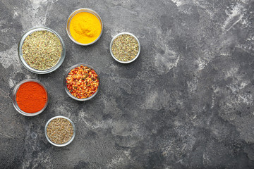 Many different spices on grey background
