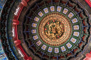 Ceiling of Forbidden City, with decoration of a golden dragon and dragon ball