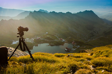 photo camera taking photos in nature mountain landscape. Fagaras, Romania