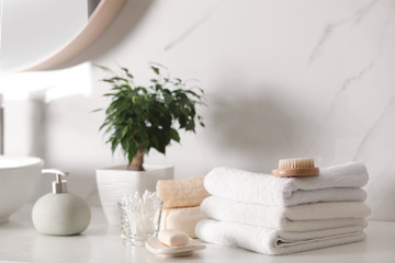 Wall Mural - Composition with soap dispenser and towels on white table indoors