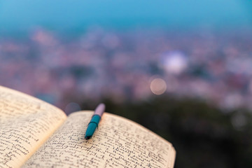 Obraz A journal notebook placed outdoors in open. selective focus. - fototapety do salonu